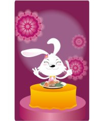 小兔子吃东西的照片_
